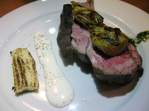 Rack of lamb, fresh goat cheese, smoked eel, artichokes, potato mousseline and mint